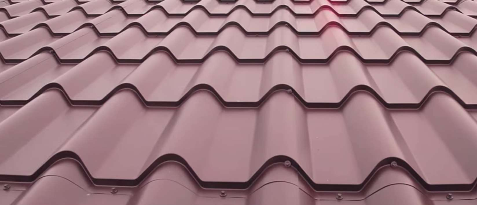an up close photo of red metal roofs